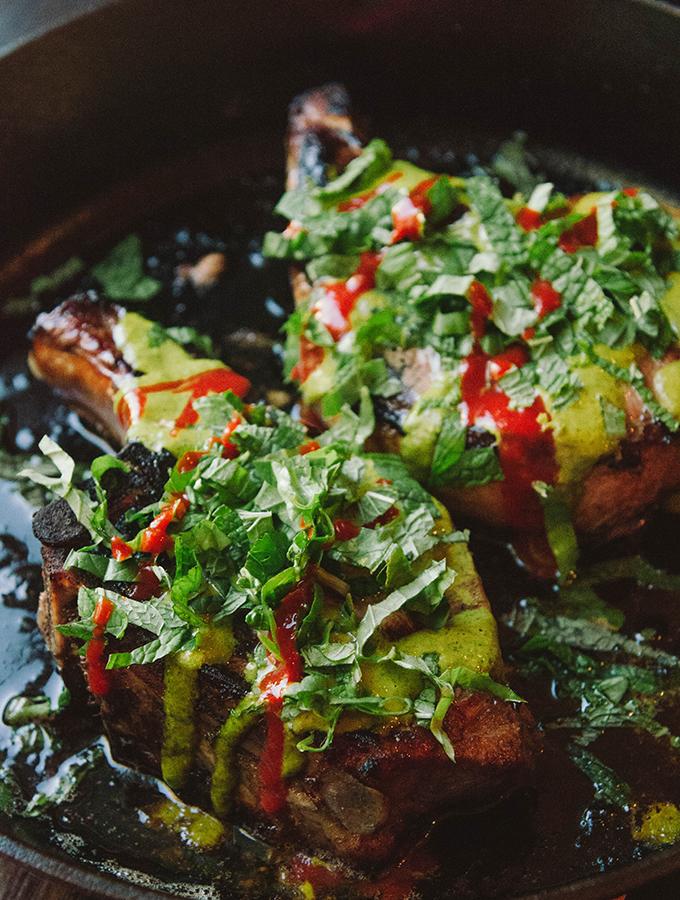 Marinated Thai Pork Chops With Spicy Cilantro Sauce & Herbs| soletshangout.com | #glutenfree #porkchop #thai #paleo #primal #skillet
