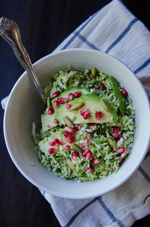 Shredded Brussels Sprout & Green Apple Salad With Avocado & Pomegranate Seeds // soletsangout.com #salad #brusselssprouts #thanksgiving #veggies #paleo #primal #glutenfree #vegan #raw