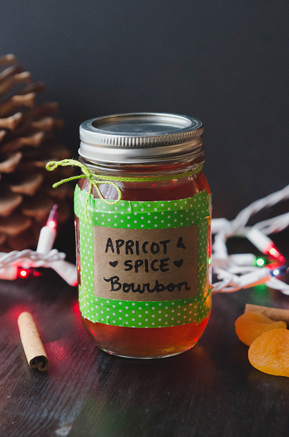 Apricot & Spice Infused Bourbon// The perfect holiday gift! #infuse #holiday #bourbon #apricot #christmas #cinnamon #booze #cocktails #drinks