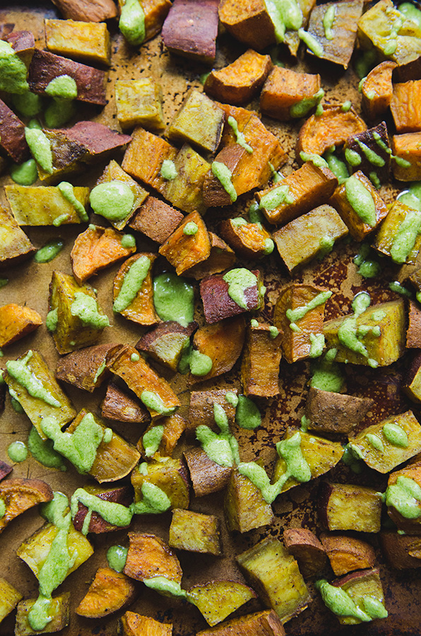 Turmeric Roasted Sweet Potatoes + Parsley Tahini Sauce by @SoLetsHangOut // www.soletshangout.com #sweetpotatoes #tahini #parsley #turmeric #fall #paleo #glutenfree #grainfree #vegan