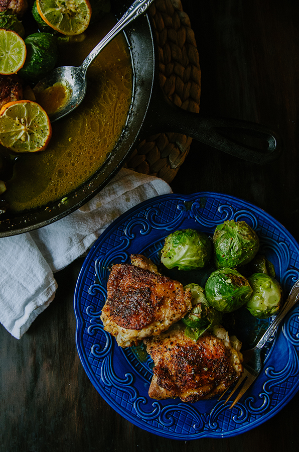One-Skillet Crispy Lemon Pepper Chicken Thighs and Whole Roasted Brussels Sprouts by @SoLetsHangOut // #paleo #glutenfree #primal #chicken #skillet #onepan #lemonpepper #brusselssprouts